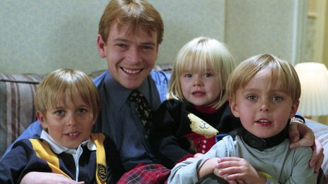 Adam Woodyatt with on-screen children