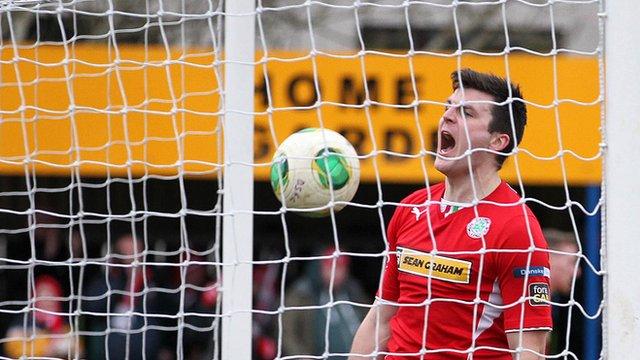 Diarmuid O'Carroll celebrates scoring the equaliser for Cliftonville