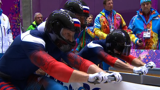 Russia have the lead after two heats of the four-man bobsleigh at the Winter Olympics.