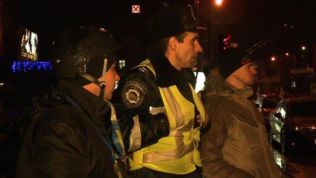 Members of a vigilante group assist traffic police in Kiev