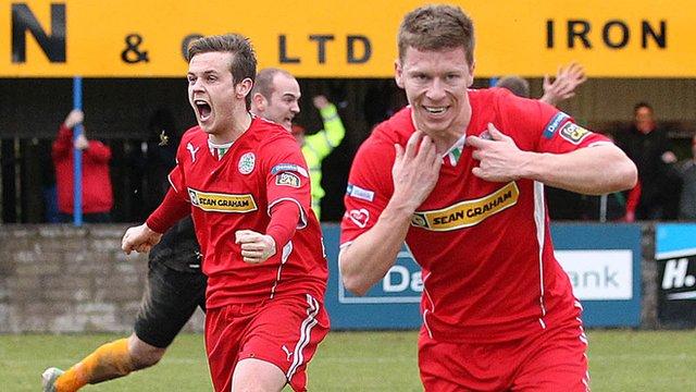 Cliftonville's Stephen Garrett celebrates scoring the winning goal against Dungannon Swifts