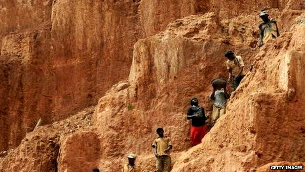 Workers up a mountain in the DR Congo