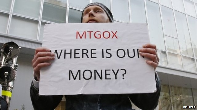 Kolin Burges holds a placard to protest against MtGox