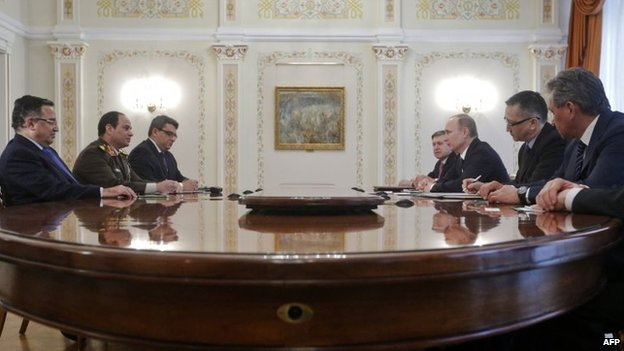 Egyptian army chief Abdel Fattah al-Sisi (2nd L) and Egypt's Foreign Minister Nabil Fahmy (L) speak with Russian President Vladimir Putin (3rd R) during their talks meet in Novo-Ogaryovo, outside Moscow, on February 13, 2014, with Russian Defence Minster Sergei Shoigu (R) attending the talks.