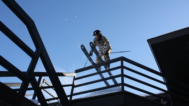 Sandy Boville skiing off a balcony railing in St Paul, Minnesota