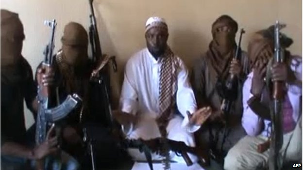 A screengrab taken from a video released on You Tube in April 2012, apparently showing Boko Haram leader Abubakar Shekau (centre) sitting flanked by militants