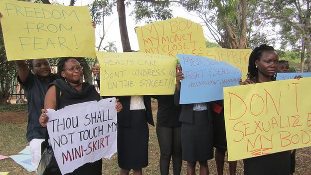 Ugandan women holding up protest placards about the anti-pornography laws which ban the wearing of miniskirts
