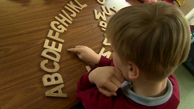 Child with alphabet letters