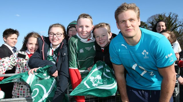 Chris Henry poses with fans at the Ireland training camp at Newforge Lane in Belfast