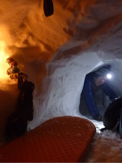 Man in snow hole