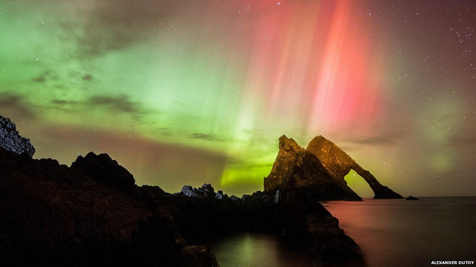 The Northern Lights seen at Bow Fiddle Rock in Portknockie, Moray.