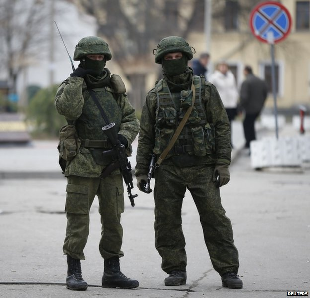 Heavily armed unidentified soldiers outside the parliament building in Simferopol, Crimea, 1 March