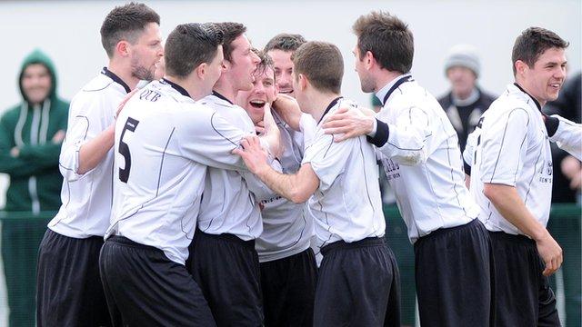 Queen's University players celebrating victory over Bangor