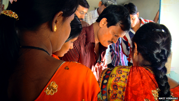 Muruganantham trains a group of women