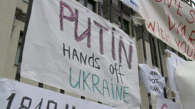 Posters outside the Russian embassy in Kiev