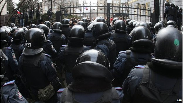 Riot policemen stand guard in front of the regional administration in Donetsk on March 3
