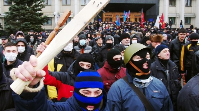 Pro-Russian activists wave clubs in Odessa on March 3, 2014.