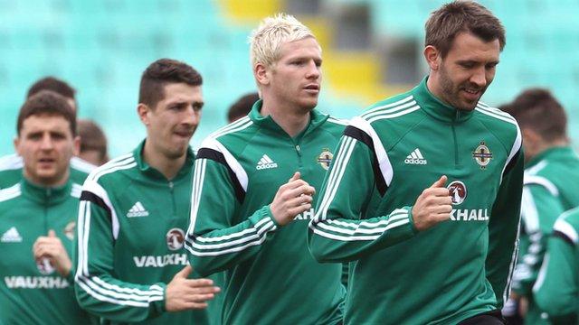 Gareth McAuley (right) training on Tuesday