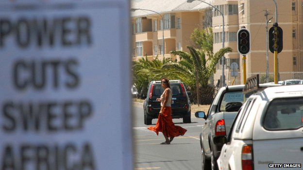 Notice reading Power Cuts Sweep South Africa on street
