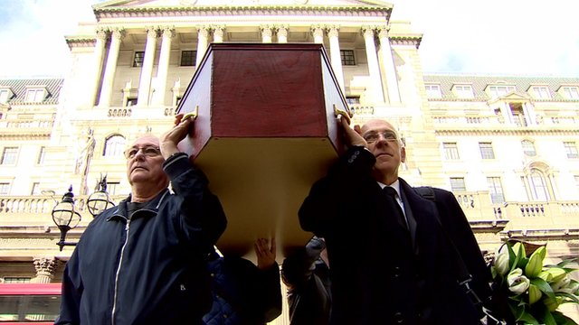 Campaigners with fake coffin