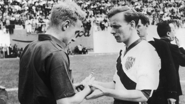 England's Billy Wright and USA's Ed McIlvenny exchange souvenirs before the match