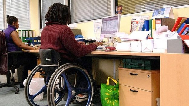 Disabled man in office