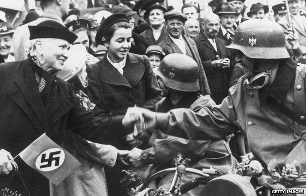 4 October 1938: Ethnic Germans living in the Sudetenland in Czechoslovakia welcome German troops