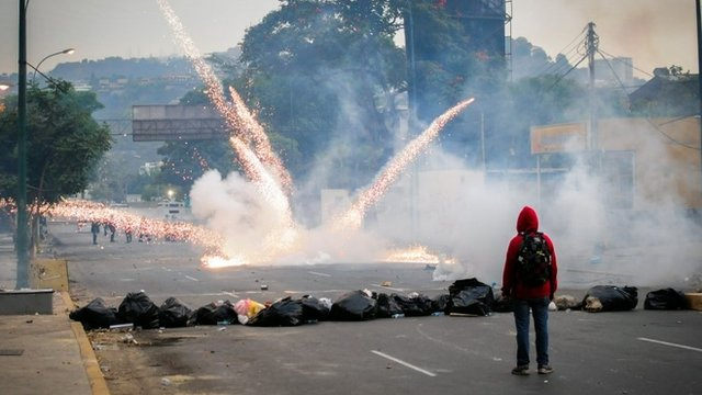 Students clash with the riot police