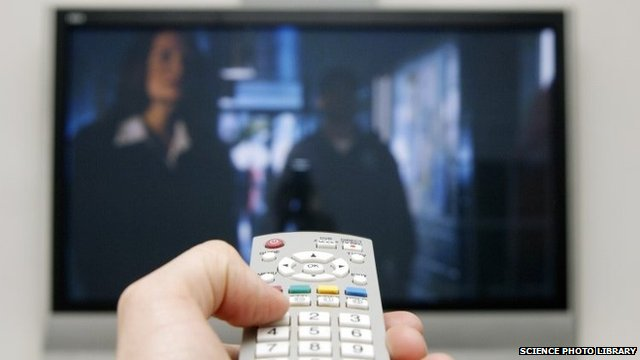 A person watching television
