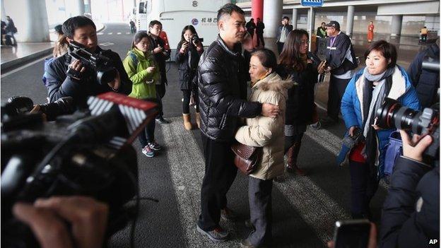 A relative of a passenger at Beijing International Airport