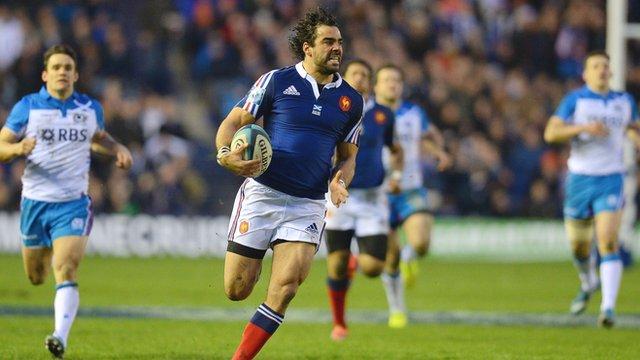France's Yoann Huget scores against Scotland