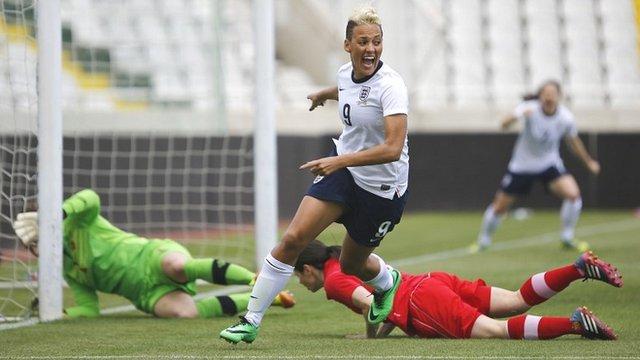 England's Lianne Sanderson celebrates after scoring against Canada
