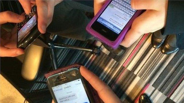 Three smart phones held in hands