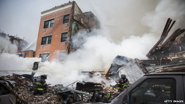 Heavy smoke poured from the debris of an explosion in Manhattan on 12 March 2014