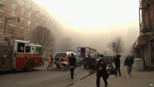 Firefighters battle a blaze at the site of a possible explosion and building collapse in the East Harlem neighbourhood of New York on 12 March 2014