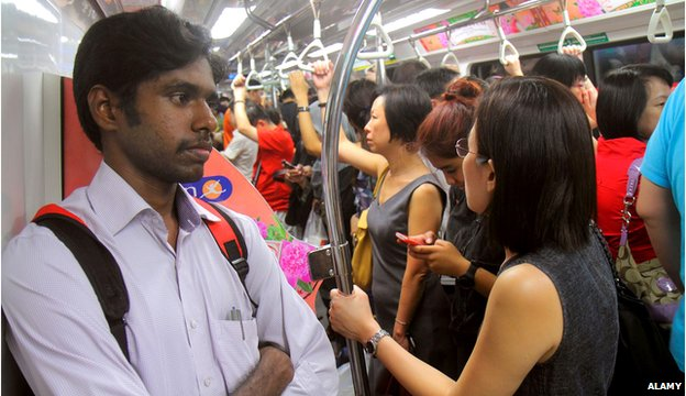 Commuters on a train in Singapore