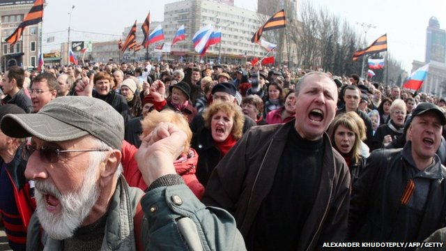 Pro-Russian activists shout slogans during a demonstration rally in the eastern Ukrainian city of Donetsk on March 15, 2014
