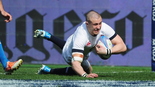 Mike Brown scores his second, and England's third try, to give them a 24-6 lead over Italy at half-time in their Six Nations match in Rome.
