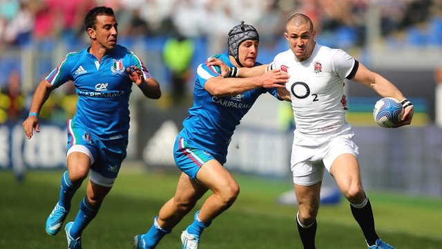 Mike Brown powers his way through to score for England against Italy