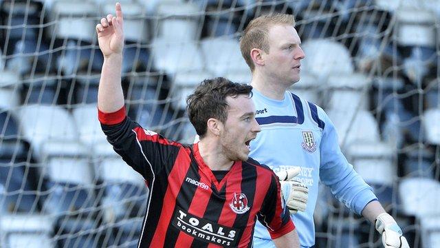 Eamon McAllister celebrates scoring against Ballymena for Crusaders