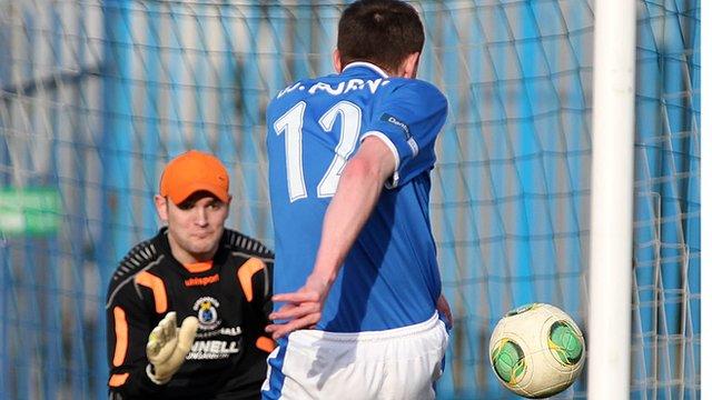 Linfield's Billy Joe Burns shoots past Gareth Buchanan of Dungannon Swifts
