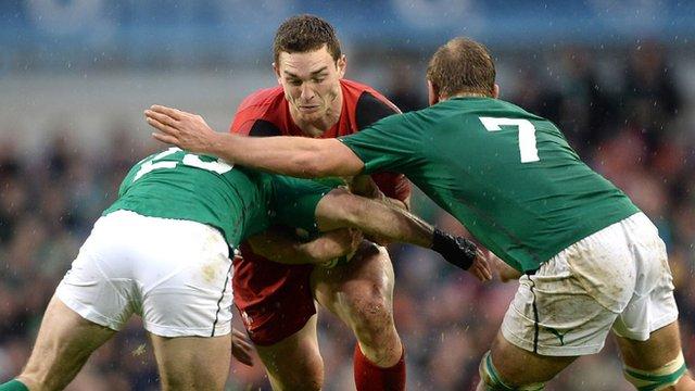 George North runs into strong Irish defence