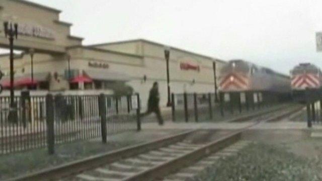 Man runs across train line