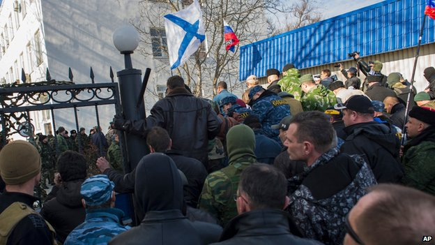 Crimean self-defence forces enter the Ukrainian naval HQ in Sevastopol on 14 March 2014