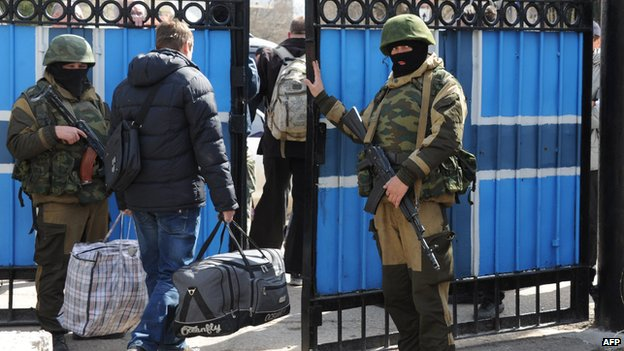 Ukrainian officers leave the navy HQ in Sevastopol on 19 March 2014
