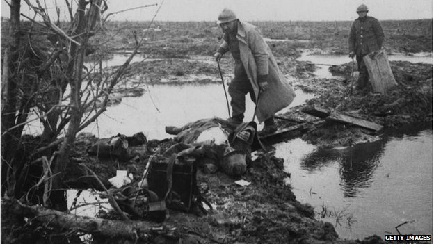 Two men searching for war material and other valuables after a battle near Ypres on 19 April 1918