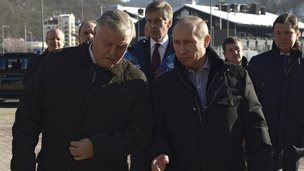 Russia's President Vladimir Putin (R) walks with Russian Railways President Vladimir Yakunin (L) during his visit to a recently constructed train station in Sochi (January 4, 2014)
