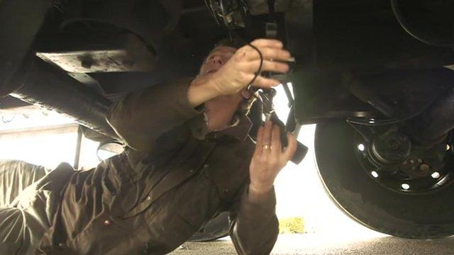 Cameraman installing night-vision camera