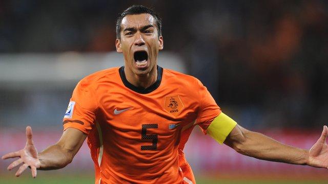 Giovanni van Bronckhorst celebrates after scoring for Netherlands against Uruguay