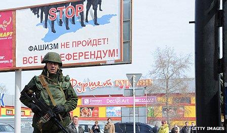 Russian soldier patrols Crimea
